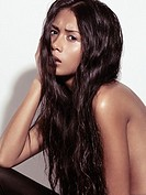 Sensual beauty portrait of a young woman with long dark hair
