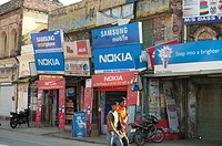 Nokia and Samsung shops on the Main street, Rishikesh, Uttarakhand, India