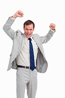 Cheering businessman with his arms up against a white background