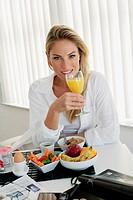 Woman having breakfast