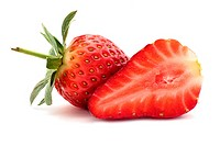 A whole strawberry and a strawberry sliced in half isolated on a white background