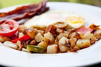 Breakfast Plate with Home Fries, Eggs and Bacon, Outdoors
