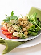 Salad with chicken breast, chick_peas and pesto dressing