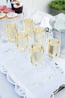 Close_up of glasses filled with white wine