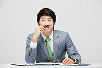 Asian Businessman At Office Desk
