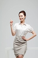 Asian Businesswoman Leaning At Desk Pointing Finger