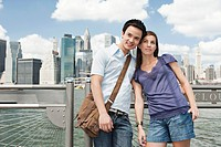 Portrait of couple in front of skyline, New York City, USA