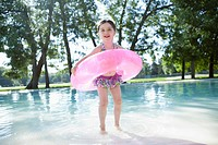 Girl 3_4 playing in water with inflatable ring