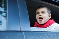 Close up of boy 5-6 sitting inside of car (thumbnail)