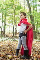 Boy 5-6 in costume standing in forest (thumbnail)