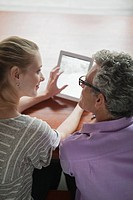 Man and woman using together digital tablet