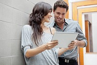 Man and woman using tablet