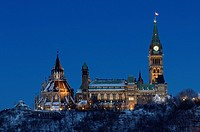 Center Block of Parliament Hill in Ottawa at dusk in winter