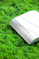 Blank Book on Green Grass