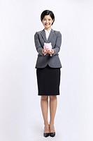 Businesswoman holding Piggy Bank