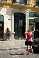 Tourists photographing themselves with the second home of Picasso in Malaga, Plaza de la Merced, 17  Malaga, Andalusia, Spain