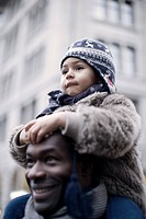 Little girl riding on father´s shoulders