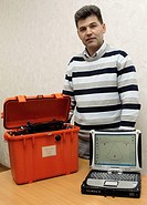 Portable radar search units. CEO of Life Sensor Co. standing with their LS_RR02 portable Rescue Radars. This type of radar was used in Japan to help f...