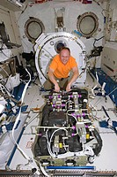 ISS maintenance. Astronaut Michael Fincke born 1967 performing maintenance on the Carbon Dioxide Removal Assembly in the Kibo laboratory of the Intern...