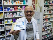 Male pharmacist holds a pack of Metformin glucophage tablets used to treat type 2 diabetes adult onset non_insulin dependent diabetes.