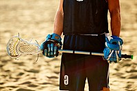 Detail of a lacrosse player on the beach