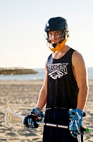 Portrait of a lacrosse player on the beach