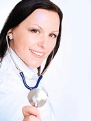 smiling brunette doctor woman holding stethoscope