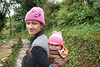 Woman with her baby on a footpath near Dhampus village - Pokhara Valley, Gandaki Zone, Nepal