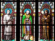 Stained Glass Window depicting three standing figures of Saints / Martyrs / Holy Men / Apostles