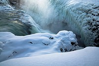Steam rising from glacial hot spring
