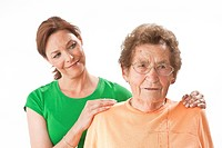 Smiling mature woman looking at old woman