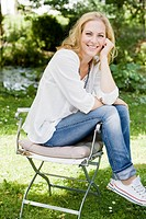 Smiling woman sitting outdoors