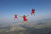 Three skydivers in the air