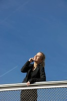 Germany, Bavaria, Munich, Businesswoman talking on phone, smiling