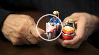 Close up of hands holding an old toy
