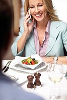 Businesswoman on cell phone in cafe