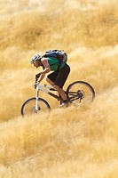 Portugal, Madeira, Mature man riding mountain bike