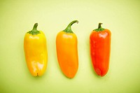 The colorful peppers with the green background