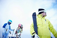 The people wearing the ski wear with the ski gear