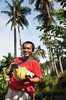 Man holding cut tropical fruit