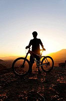 A silhouette of a mountain biker at sunset on Gooseberry Mesa in southern Utah.