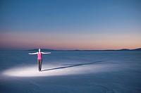 Runner standing in desert landscape