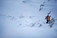 Snowboarder rappeling, Oberjoch, Bad Hindelang, Bavaria, Germany