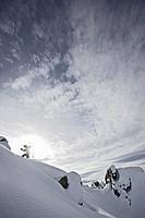 Snowboarder ascending, Chandolin, Anniviers, Valais, Switzerland