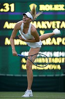 England, London, Wimbledon. Maria Sharapova RUS in action in a match against Anna Chakvetadze RUS on Centre Court at the Wimbledon Tennis Championship...