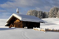 Snow covered alpine hut, Alpe di Siusi, Schlern, South Tyrol, Italy, Europe