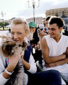 Teenage friends with little dog at Manege square, Moscow, Russia, Europe