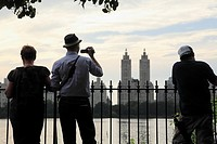 Visitors in the edge of the Reservoir in Central Park with El Dorado Apartments in the background  Manhattan  New York City  USA.