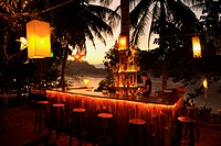 Bar under palm trees, Mekong river after sunset, Luang Prabang, Laos