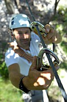 A person fixing a carabiner at a climbing rope, Climbing Park Partschings, Alto Adige, South Tyrol, Italy, Europe